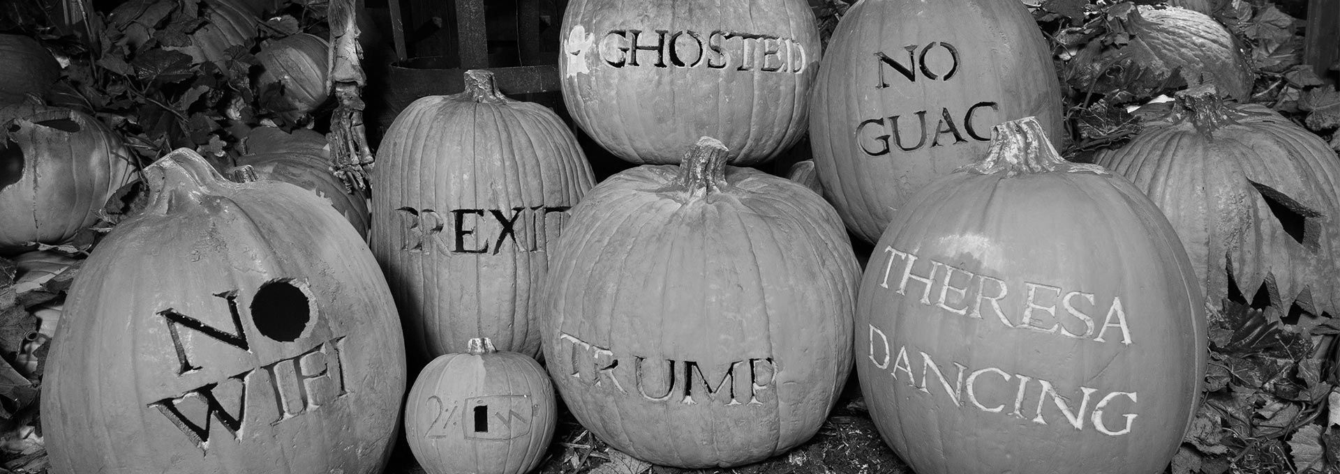 Carved pumpkins with phrases